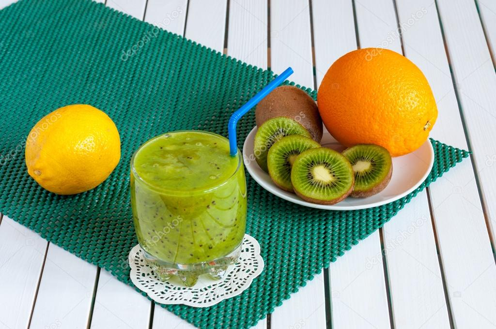 Delicious array of fresh fruit juices served in tall glass made from liquidised kiwifruit and orange, lemon for healthy summer treats rich vitamins