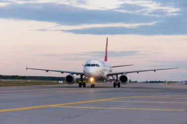 KIEV, UKRAINE - JULY 10, 2015: Turkish Airlines Airbus A320 taxiing to the gate after landing at Borispol international airport.