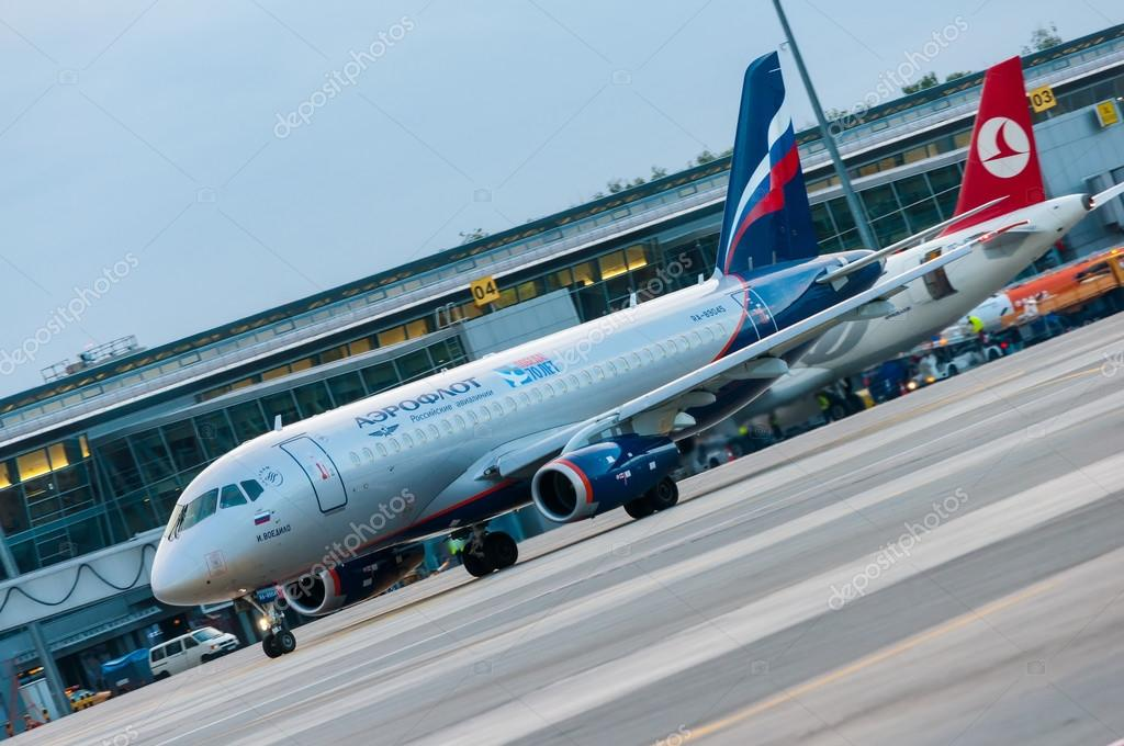 KIEV, UKRAINE - JULY 10, 2015: Aeroflots  SSJ 195-b taxis to teminal at KBP Airport on January 12, 2014. Aeroflot is flag carrier and largest airline of the Russian Federation.