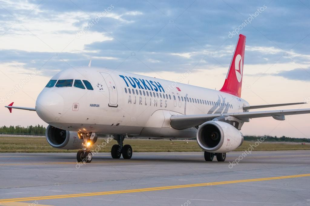 KIEV, UKRAINE - JULY 10, 2015: Turkish Airlines Airbus A320 at Borispol International Airport, Kiev, Ukraine. TurkisH Airline has over 18,000 employees and a fleet of 261.