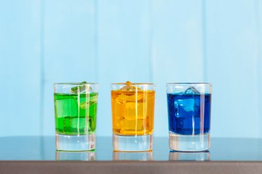 Collection of alcoholic cocktails in shot glasses. Shots. Colorful  drinks