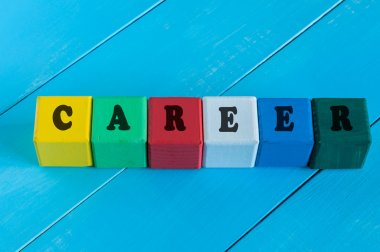 Word Career on childrens colourful cubes or blocks. Colourful wooden background