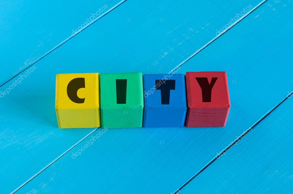 Word City on childrens colourful cubes or blocks. Colourful wooden background