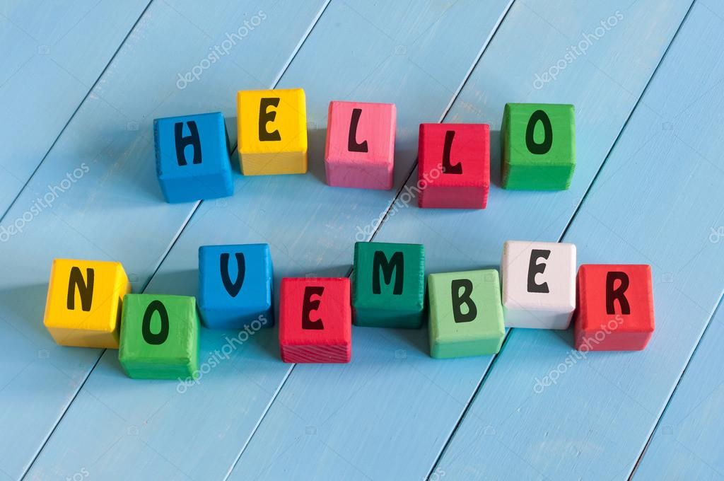 Word Hello November On childs toy cubes on wooden rural  background.