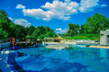 09.09.2020. Bursa, Turkey. Magnificent pool for animals in Bursa Zoor during sunny day and bright sky background.
