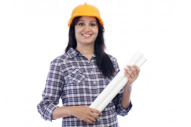 Smiling female architect with blue print