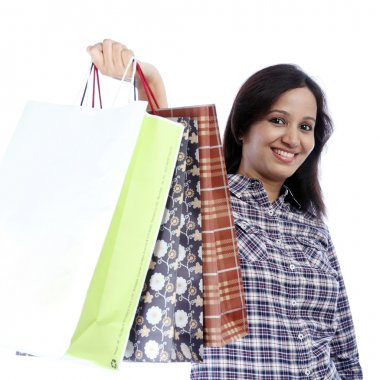 Young indian girl holding shopping bags