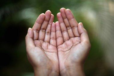 Closeup view of praying hands