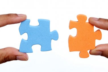 Hands trying to attach two jigsaw puzzle pieces on white background stock vector
