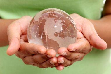 Glass globe in woman hands