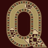 Orientální dřevěná mozaika zdobené písmeno Q