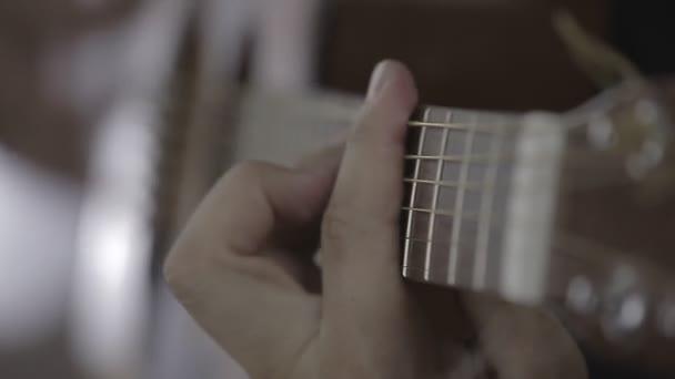 Man Playing Guitar Close Up CineStyle Flat Video