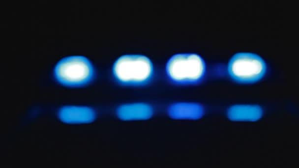 Rozostřeného policejní auto světla na místo činu