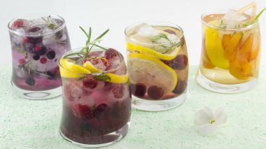 Natural fruit iced-T juice with ice, lemon and sliced fruits in