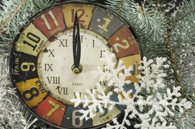 Vintage clock for New years eve and snowflakes