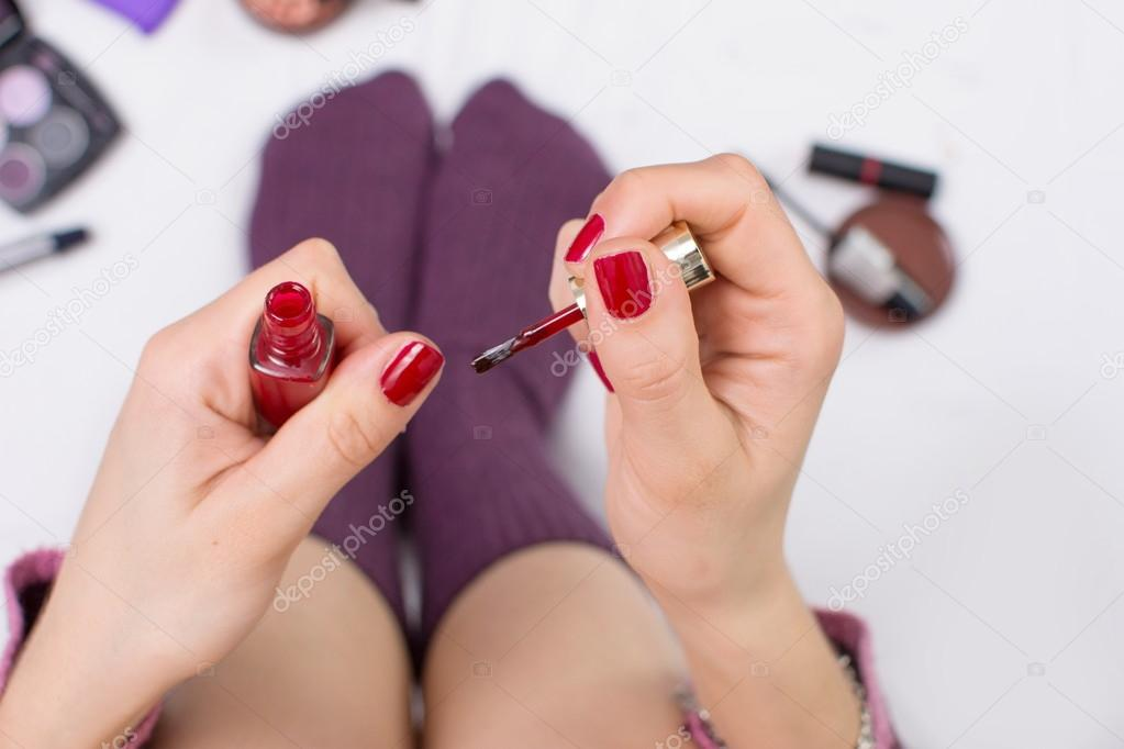 Girl girl nail polishing in bed — Stock Photo © CreativeFamily #98250134