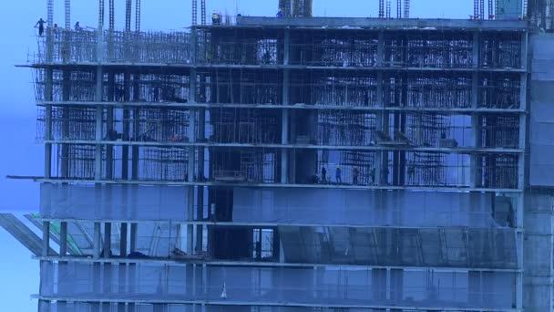 sziluettépület, munkás, beton és felszerelés