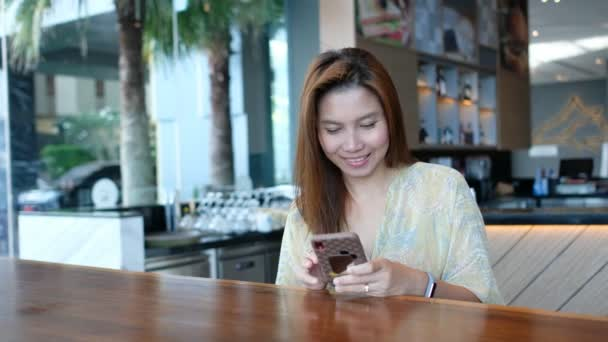 Asian girl using smartphone, woman watching mobile