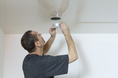 Electricians neatly sets spotlight on suspended ceilings.