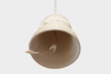 Clay bell on a white background.