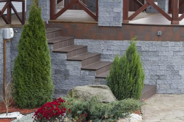 Porch steps lined with ceramic tiles.
