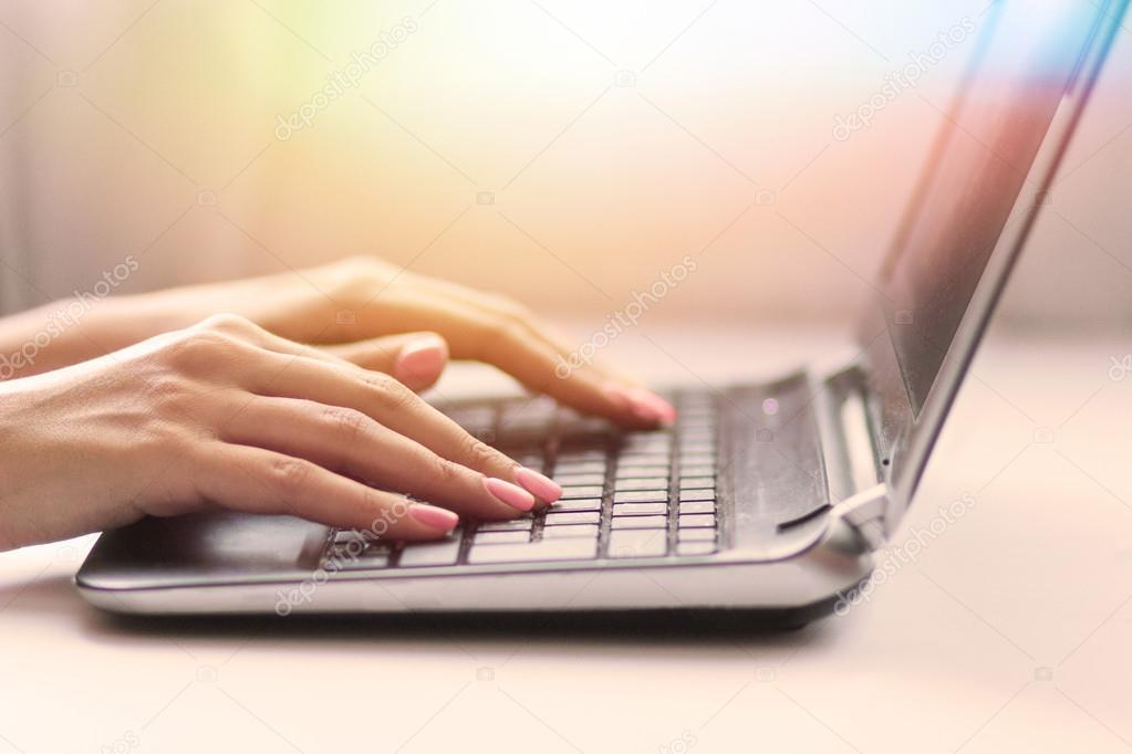 Closeup of woman with laptop