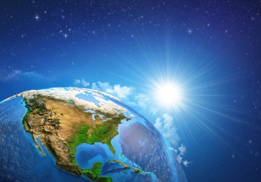 Rising sun over the Earth and its landforms, view of the United States of America. Elements of this image furnished by NASA stock vector