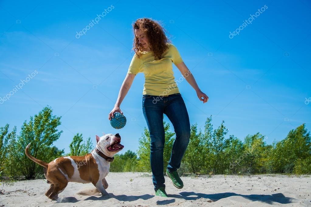 Girl with a dog on the nature