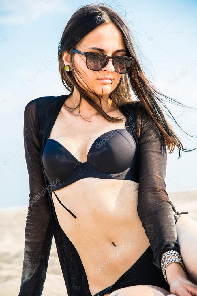 Girl in a black bathing suit
