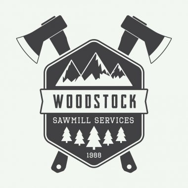 Vintage sawmill logo with axes, rocks, trees