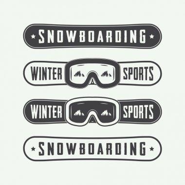 Vintage snowboarding logos, badges, emblems and design elements. Vector illustration stock vector