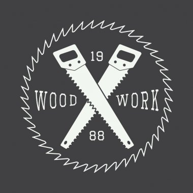 Vintage sawmill logo with saws.
