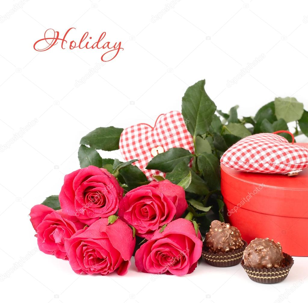 Bouquet of roses, hearts and box of chocolates on a white background. Festive background.