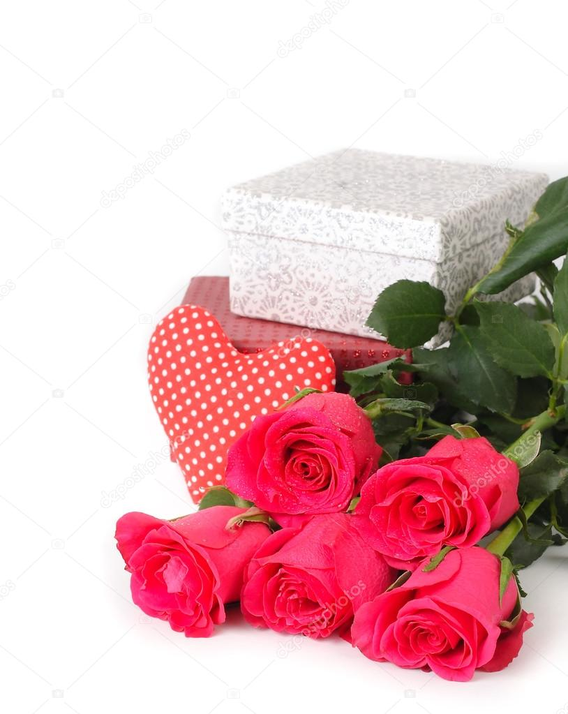 Pink roses and gift boxes on a white background.