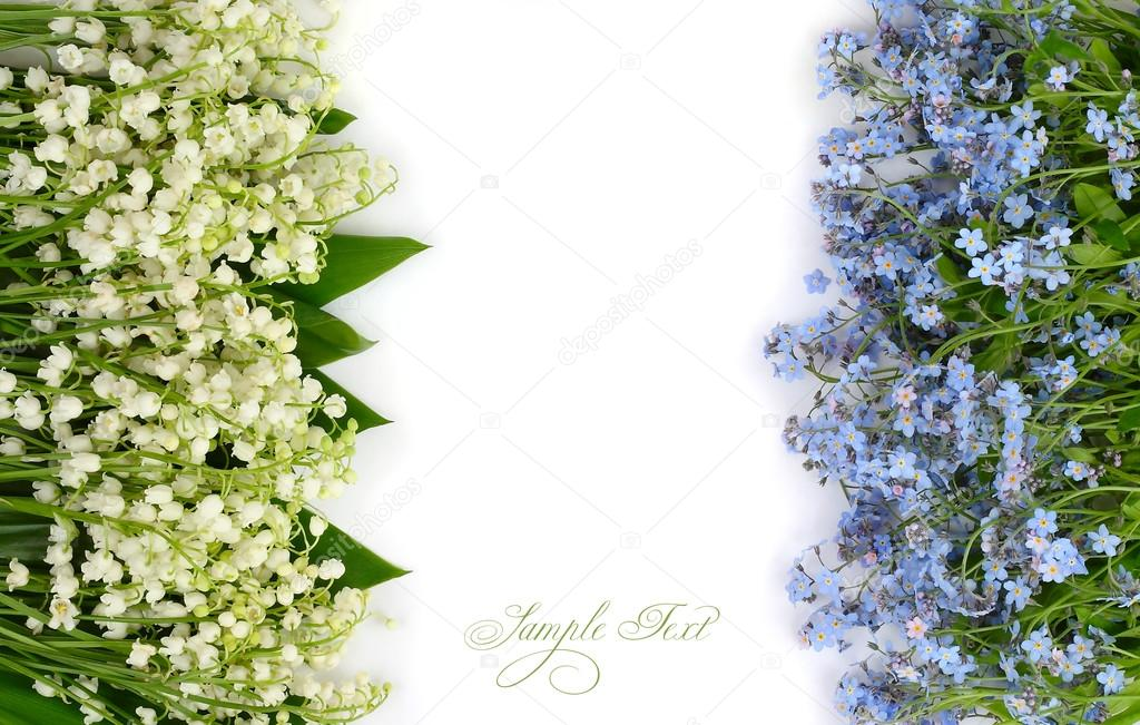 Flower background with lilies of the valley and blue flowers with a place for the text. Top view.