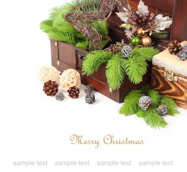 Decorative Christmas star, branches of a Christmas tree and the cone in a wooden chest on a white background. A Christmas background with a place for the text.