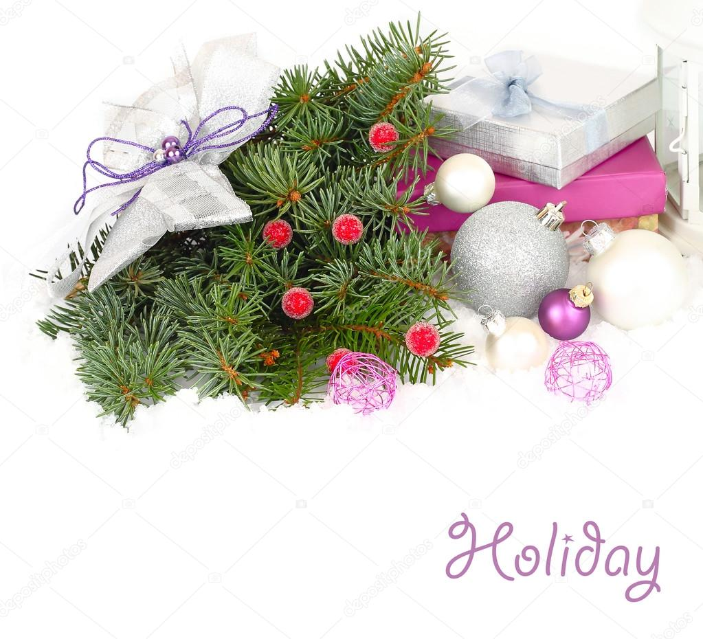 Christmas composition with branches of a Christmas tree, fir-tree plank beds and gift boxes on a white background. A Christmas background with a place for the text.