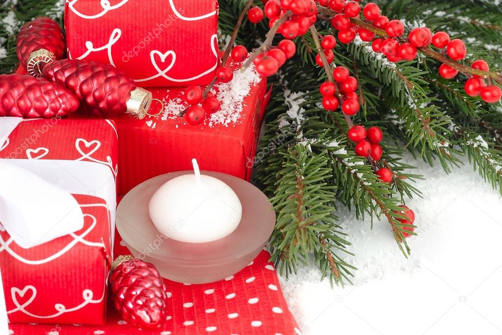 Red gift box with a white bow on a white background. A Christmas background with a place for the text.