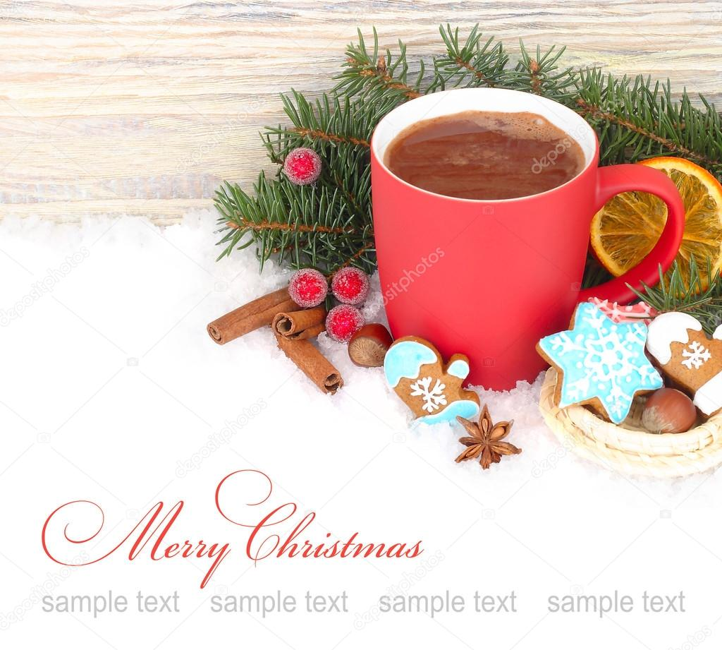 Red mug of hot chocolate, cinnamon and ginger cookies on snow on a white background. A Christmas background with a place for the text.