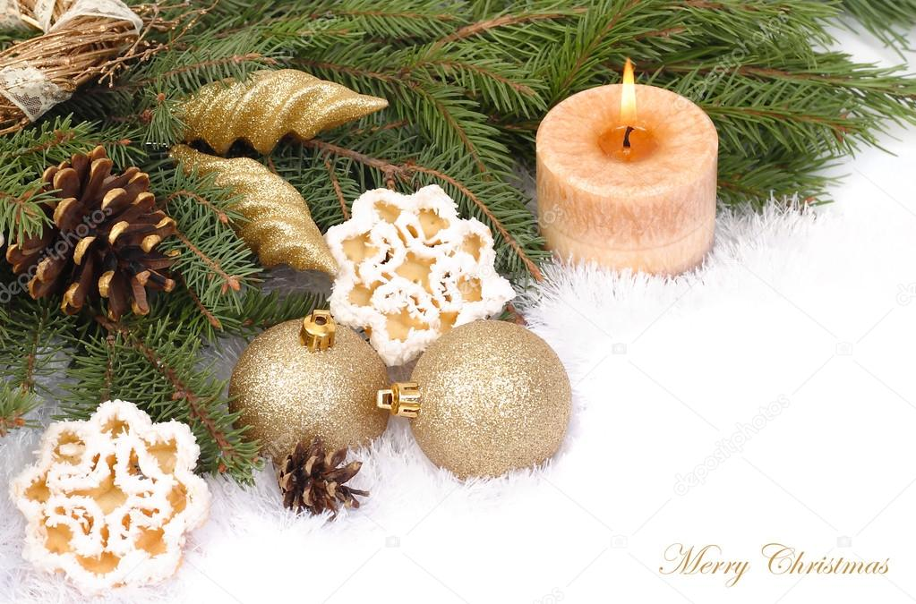 Christmas composition with golden Christmas balls and cones on snow-covered branches of a Christmas tree on a white background. A Christmas background with a place for the text.