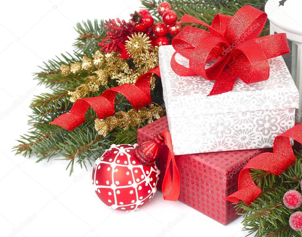 Christmas gift boxes with a red bow and red christmas ball on christmas gift boxes with a red bow and red christmas ball on branches of a christmas tree on a white background a christmas background with a place for negle Gallery