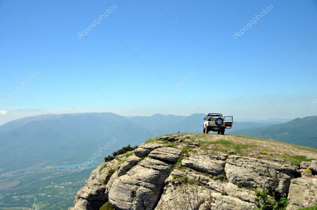 car on top of the mountain