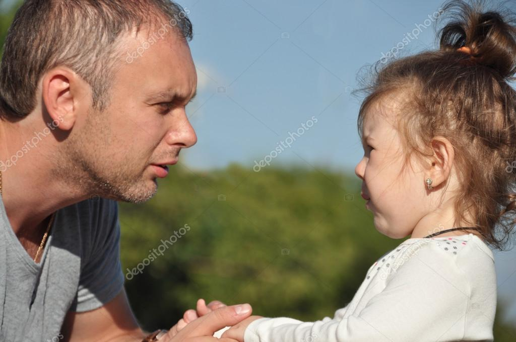 Father listening to distressed daughter. Parenting concept