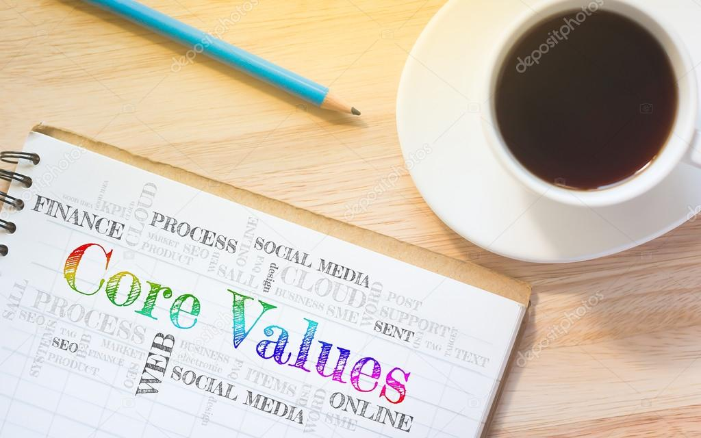 Concept Core Values message on book. A pencil and a glass coffee ...