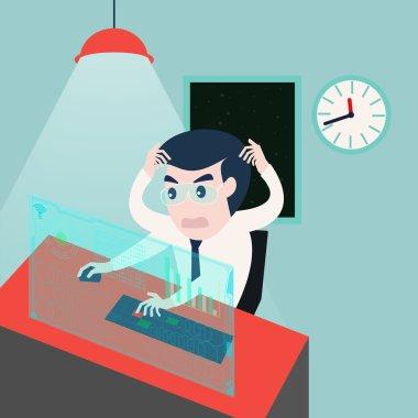Businessman working on computer problems