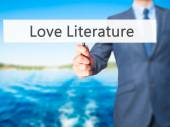Fotografie Love Literature - Businessman hand holding sign