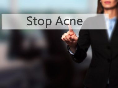 Stop Acne - Businesswoman hand pressing button on touch screen i