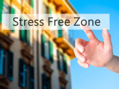 Stress Free Zone - Hand pressing a button on blurred background