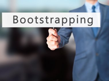 Bootstrapping - Businessman hand holding sign