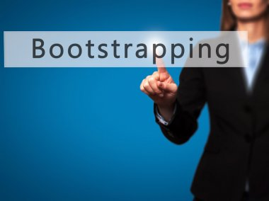 Bootstrapping - Businesswoman hand pressing button on touch scre